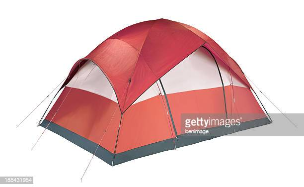 Red and white camping tent pitched to the ground