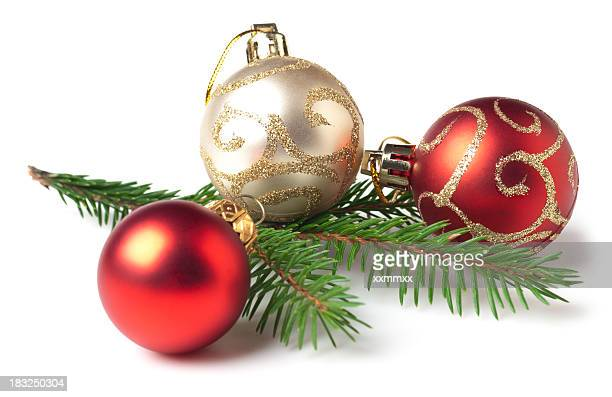 red and white christmas bulbs and tree branch - christmas ornaments stock photos and pictures