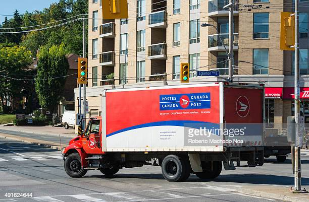 Red and white color Canada Post delivery truck passing through a traffic junction Canada Post or Postes Canada is the crown corporation which...