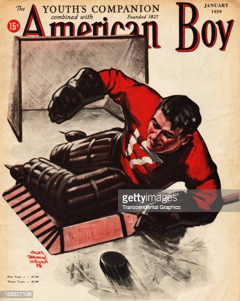 NEW YORK JANUARY A red and white cover of the American Boy magazine for January of 1939 has a hockey illustration
