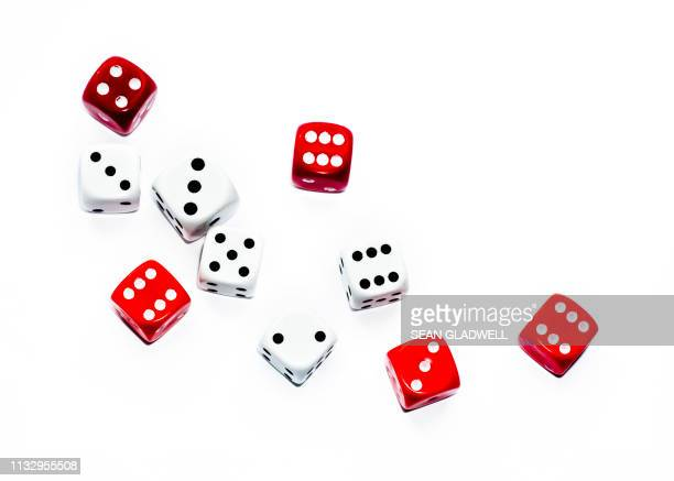 red and white dice - addiction stock pictures, royalty-free photos & images