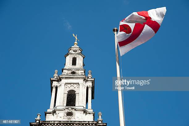 CONTENT] Red and White flag and the spire of St Mary le Strand church on the Strand in Central London