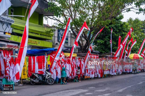 red and white flags and banners as a symbol of state in august, banyuwangi, indonesia - indonesia flag stock photos and pictures