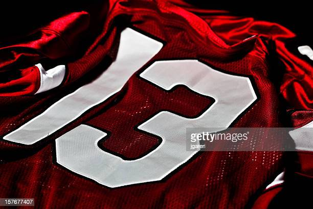 red and white jersey - american football strip stock pictures, royalty-free photos & images