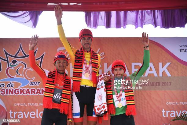 Red and White jersey winner Jamal Hibatullah of KFC Cycling Team Indonesia yellow jersey winner Khalil Khorsid of Tabriz Shahrdary Team Iran and...