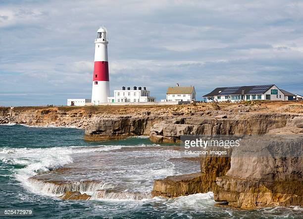 Red and white lighthouse on the coast at Portland Bill, Isle of Portland, Dorset, England.