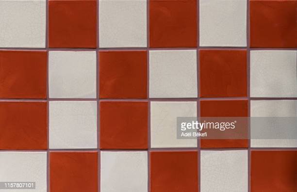 red and white mosaic wall - roof tile stock pictures, royalty-free photos & images