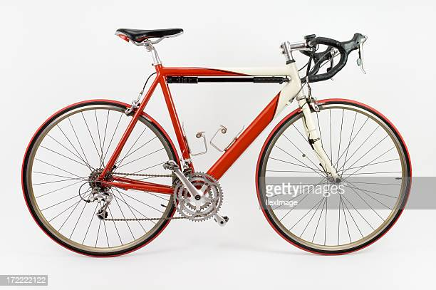 Red and white racing touring bike with white background