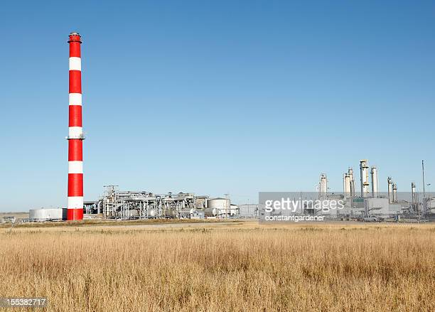 Red And White Refinery In Prairie Setting