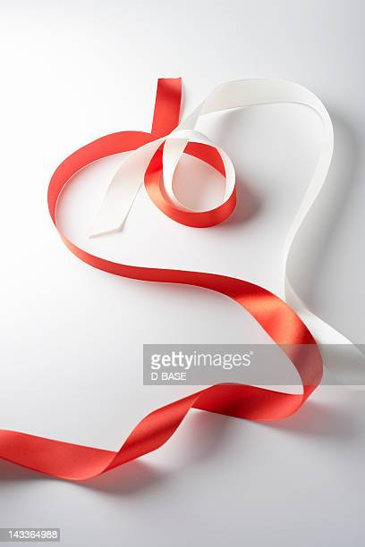 red and white ribbon made heart shape