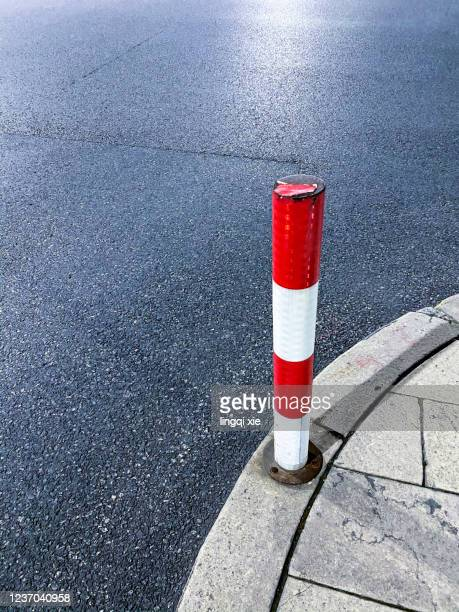 red and white road signs on the road - semaphore stock pictures, royalty-free photos & images