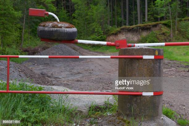 Red and white striped boom barrier