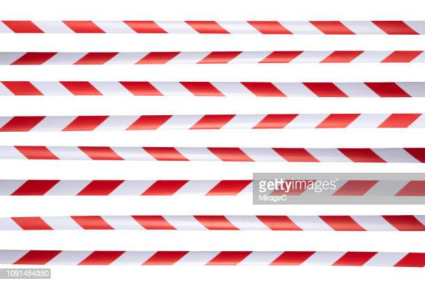 red and white striped cordon tape - cordon boundary stock pictures, royalty-free photos & images