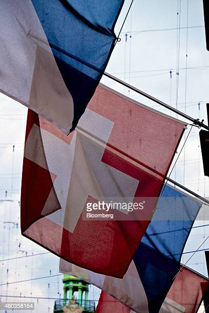 A red and white Swiss national flag flies between blue and white Zurich canton flags above the entrance to a building in Zurich Switzerland on...