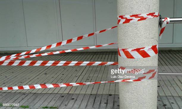 Red and white tape block the way