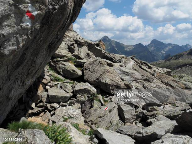 Red And White Trail Markers On Granite Rocks Along Alpine Trail In Robiei
