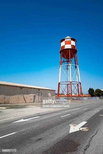 Red and white water tower with road and arrow markings within the secure area of the NASA Ames Research Center campus in the Silicon Valley town of...