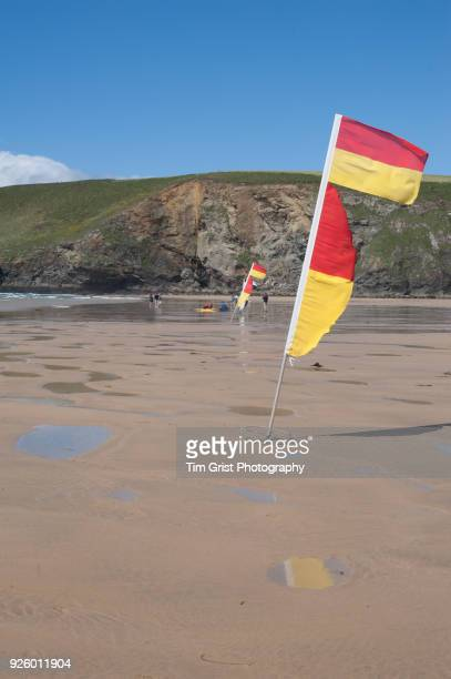 Red and Yellow Lifeguard on Patrol Flag on an empty beach