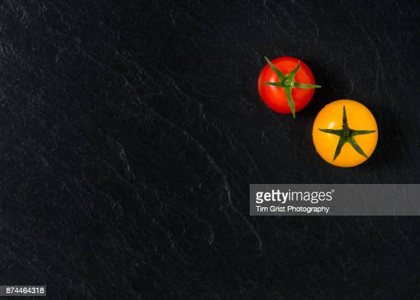 Red and Yellow Tomatoes on Slate Surface