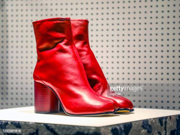 red ankle boots - red boot stock pictures, royalty-free photos & images