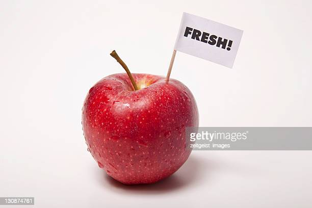 red apple, flag saying fresh! - captions stock photos and pictures