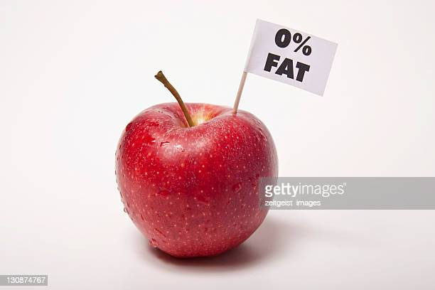 red apple, flag with the inscription 0% fat - captions stock photos and pictures