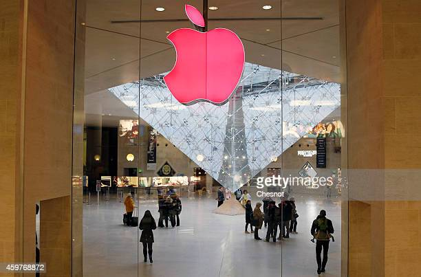 A red Apple logo is displayed during the launch of the world AIDS day 2014 campaign at the Apple store Paris on December 01 2014 in Paris France...