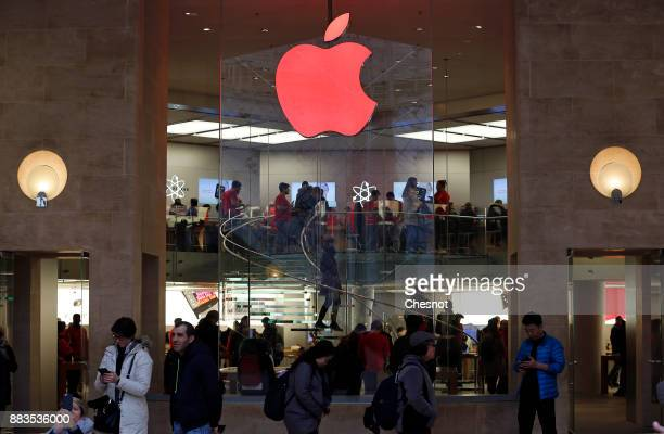 A red Apple logo is displayed during the launch of the world AIDS day 2017 campaign at the Apple store Paris in 'Carrousel du Louvre' on December 01...
