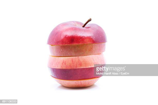 Red Apple Slices Over White Background