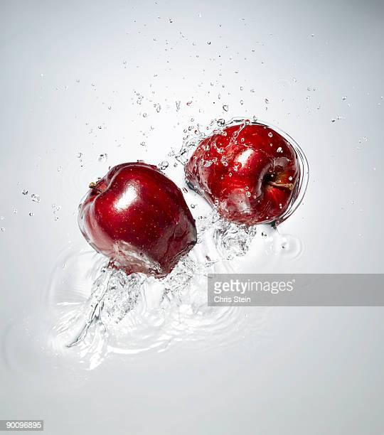 Red Apple splashing in to water