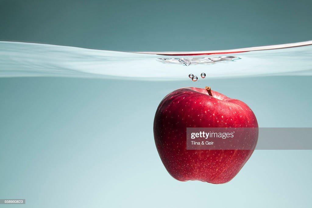 Red apple underwater : Stock Photo