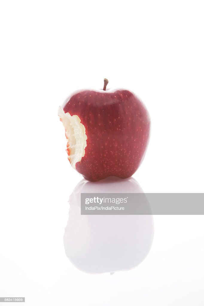 Red apple with bite mark : Stock Photo