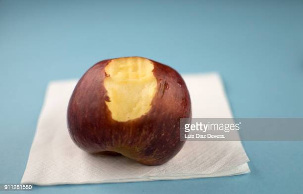 red apple with large bite - royal gala apple stock photos and pictures