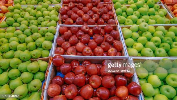 red apples in supermarket basket