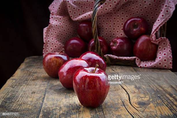 red apples on dark wood - seduction stock pictures, royalty-free photos & images