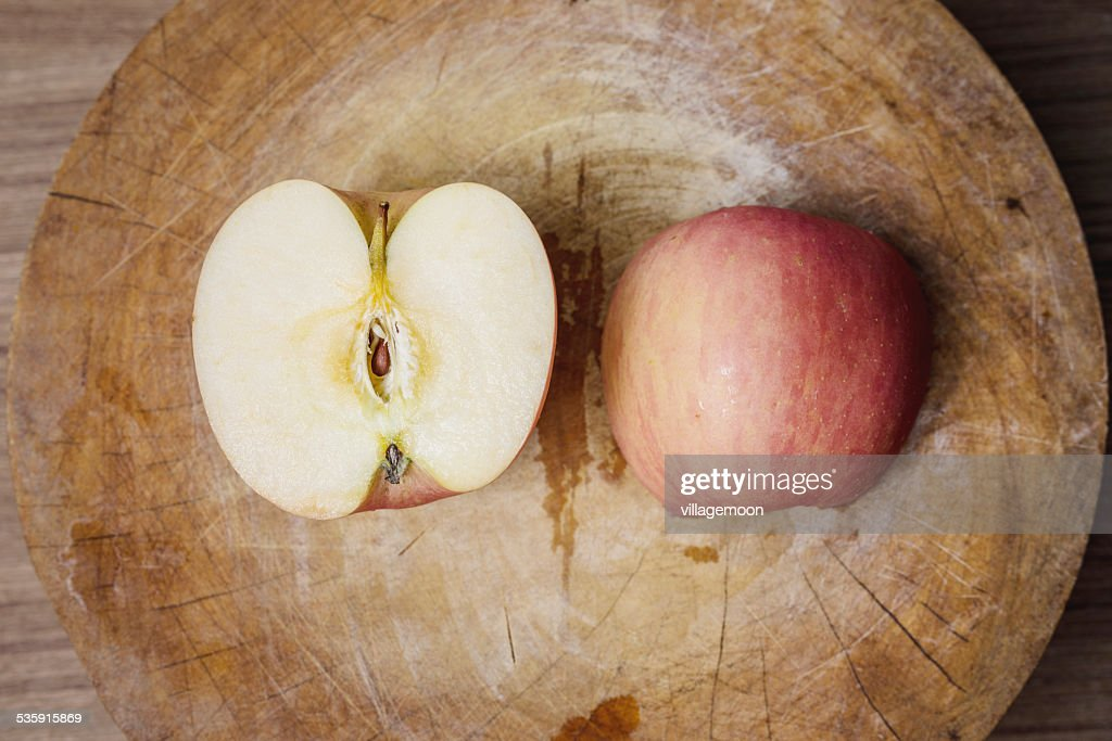 Red apples on wooden cutting board : Stock Photo