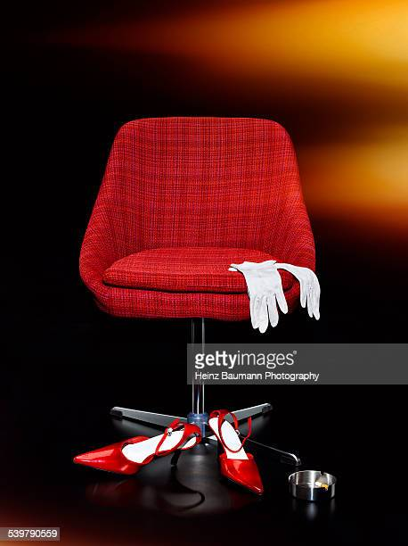 red archair - heinz baumann photography stock-fotos und bilder