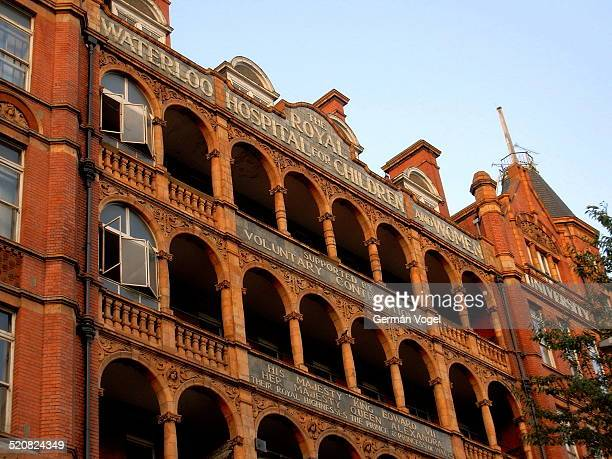Red arches of Royal Waterloo Hospital for Children and Women in London now dormitories of the University of Notre Dame