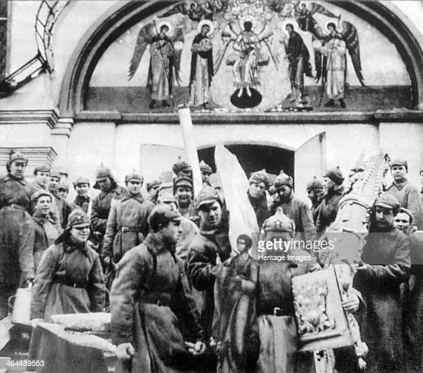 Red Army men confiscating church treasures of the Simonov monastery Moscow USSR 1925 The monastery was founded in 1370 The Bolsheviks closed it in...