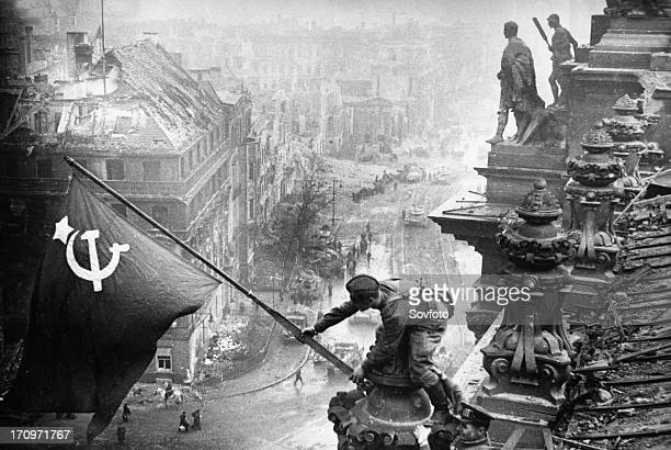 Red army soldiers raising the soviet flag over the reichstag in berlin, germany, april 30 photo taken by vladimir grebnev.