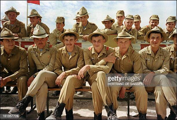 A Red Army soldiers smile 16 August 1988 during a parade as Soviet Army troops stop in Kabul prior to their withdrawal from Afghanistan The Soviet...