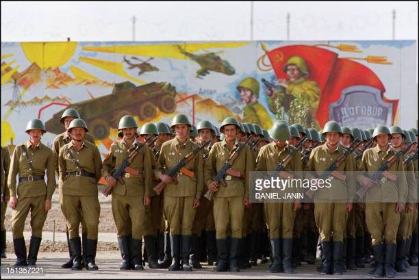 Red Army soldiers stand for review 19 October 1986 in downtown Kabul during a parade shortly before they returned to the Soviet Union The Soviet...