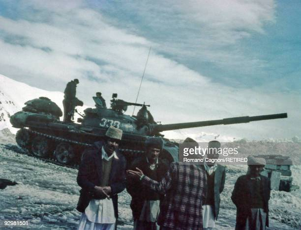 A Red Army tank and soldiers in the Hindu Kush mountains during the invasion of Afghanistan by the Russians January 1980 In the foreground are a...