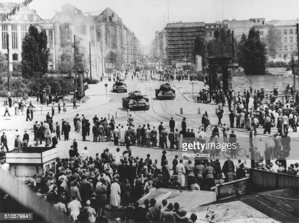 Red Army tanks move up the Leipzigerstrasse toward the Potsdamerplatz to stop the rioting after the Communist 'People's Police' had failed to...