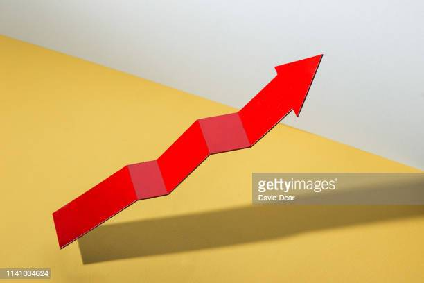 red arrow pointing upwards - hovering stock photos and pictures