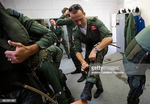 Red Arrow's Flight Lieutenant Joe Hourston puts on his flight suit before a practice session at RAF Akrotiri on May 19 2014 in Limassol Cyprus The...