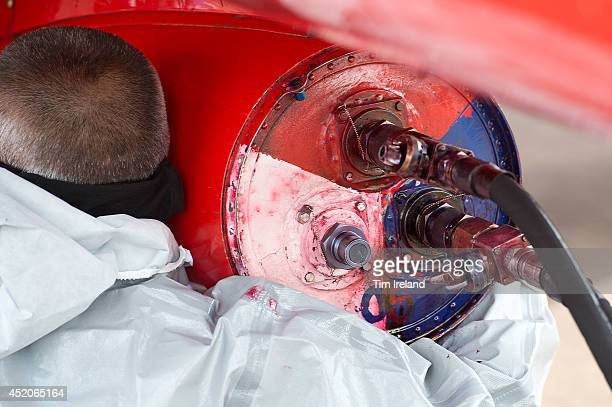 Red Arrows ground crew refill the smoke pods during the Royal International Air Tattoo at RAF Fairford on July 12, 2014 in Fairford, England. The...