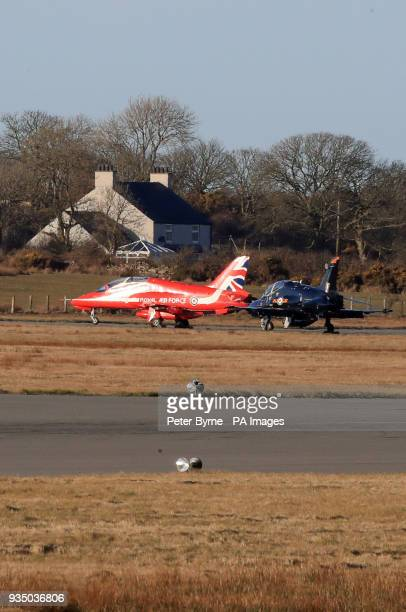 A Red Arrows jet and a Hawk on the tarmac at RAF Mona in north Wales after another of the Red Arrows crashed nearby at RAF Valley