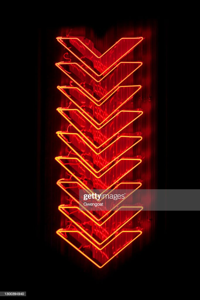 Red arrows neon light pointing down : Stock Photo