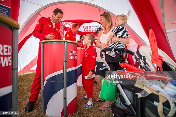 Red Arrows pilots meet the public and sign autographs as part of the celebrations for the their 50th display season during the Royal International...